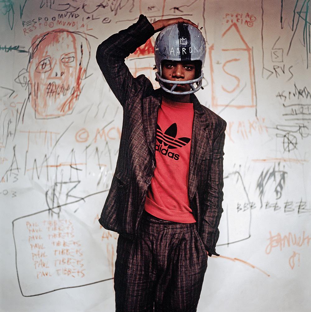 Edo Bertoglio, Jean-Michel Basquiat wearing an American football helmet, 1981, Photo: © Edo Bertoglio, courtesy of Maripol, Artwork: © VG Bild-Kunst Bonn, 2017 & Estate of Jean-Michel Basquiat, Licensed by Artestar, New York