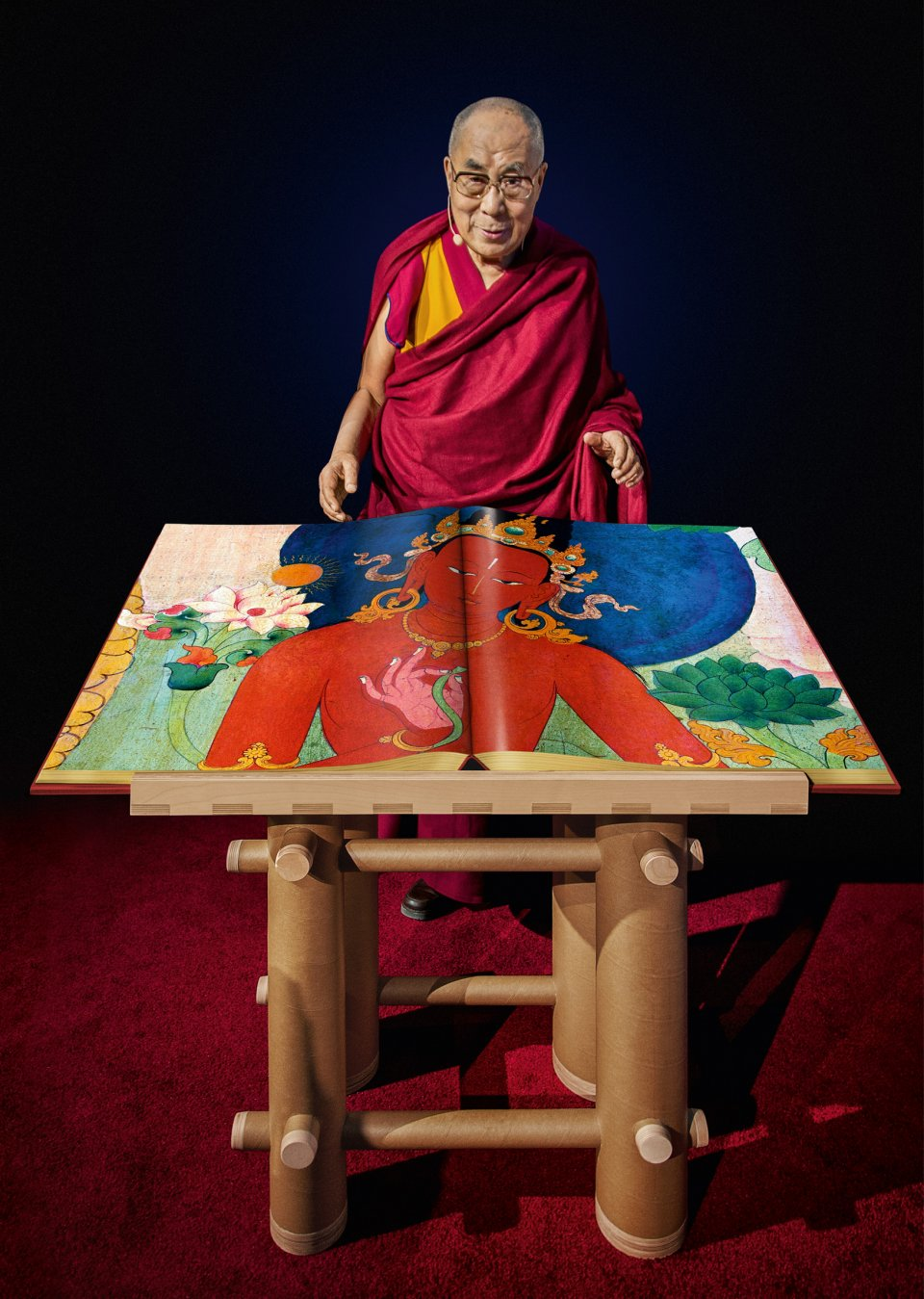 Tenzin Gyatso, the Fourteenth Dalai Lama, with a draft copy of Murals of Tibet, Boston, 2014. Copyright: Photo: Mina Magda / TASCHEN