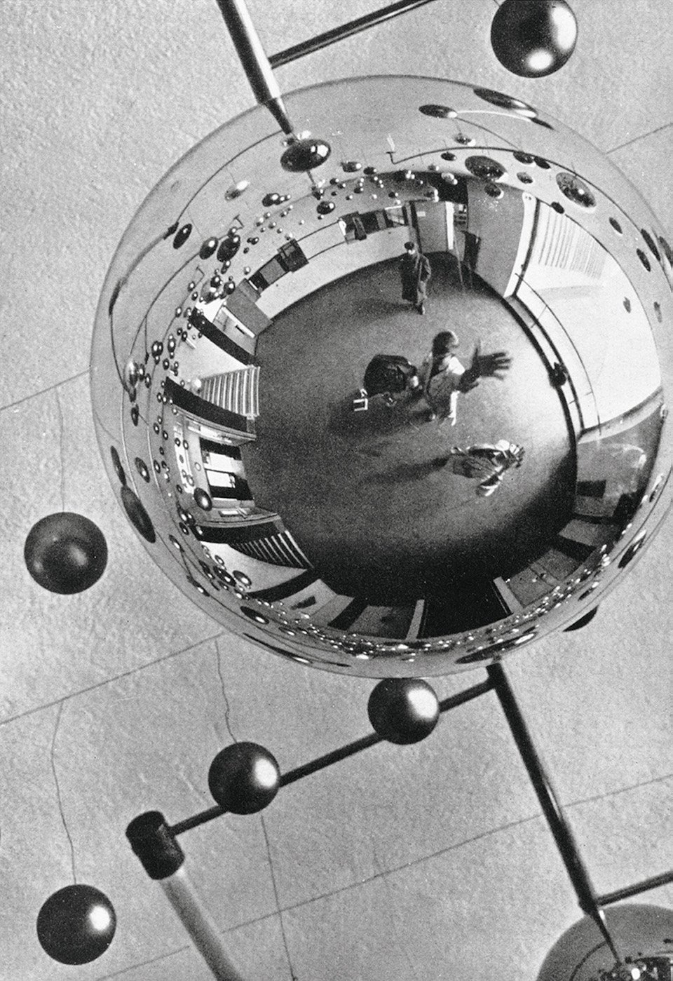 Seite 315 | Walter Funkat: The lobby of the Bauhaus building, reflected in one of the glass spheres which decorated the buidling during the Metallic Festival, 1929. Copyright: Bauhaus-Archiv, Berlin Inv. F2004/49.1; © Bauhaus-Archiv, Berlin
