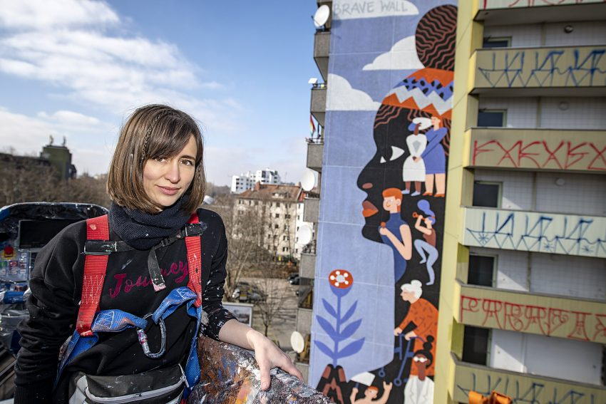 """Kate Voronina paints the """"Brave Wall"""" for Urban Nation and Amnesty International for International Women's Day, assisted by Emily Eldridge at Gitschiner Straße 66 in Berlin in February 20201. Photo by @nikakramer @voroninakate @emily_eldridge_art @urbannation_berlin @amnesty @amnestydeutschland #urbanart #streetart #streetartberlin #berlinstreetart #urbannation #urbannationberlin #urbannationmuseum #berlin"""